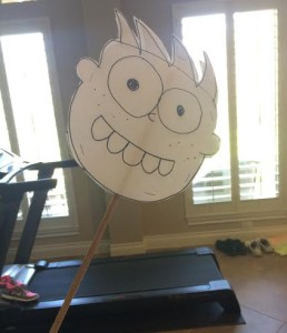 We drew a kid's face and stapled it to a stick for a real authentic monster workout.